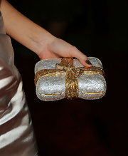 Katie Cassidy held her Swarovski crystal clutch tight while on the red carpet. Complete with a sparkling bow this clutch is worth holding on to!