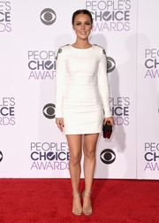 Camilla Luddington finished off her red carpet attire with silver ankle-strap sandals by Stuart Weitzman.