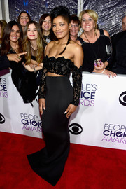 Keke Palmer looked daring at the People's Choice Awards in a black lace off-the-shoulder crop-top by Yousef Al-Jasmi that looked like a wardrobe malfunction in the making!