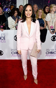 Cheryl Burke suited up in sweet style with this pink jacket and pants combo for the People's Choice Awards.