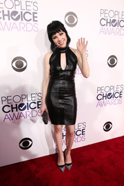 Carly Rae Jepsen styled her dress with a pair of two-tone glitter pumps.