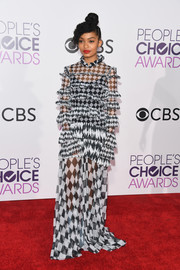 Yara Shahidi donned a busy-looking harlequin-print ruffle gown by Off-White for the 2017 People's Choice Awards.