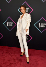 Victoria Beckham was sleek in a white pantsuit from her label at the 2018 People's Choice Awards.