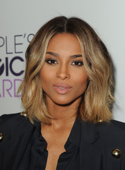 Ciara styled her hair in a center part with sexy waves for the People's Choice Awards nominations press conference.