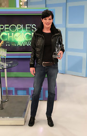 Pauley wore a black leather jacket with jeans and a thick belt.