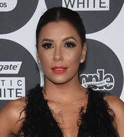 Eva Longoria went for simple styling with this center-parted ponytail at the People en Espanol 50 Most Beautiful Gala.