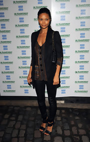 Thandie paired her leather leggings with double strap leather sandals.