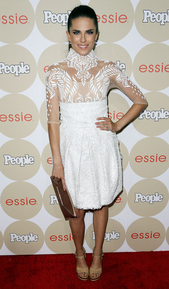 Karla Souza showed some skin in a white cocktail dress with a see-through bodice during People's Ones to Watch party.