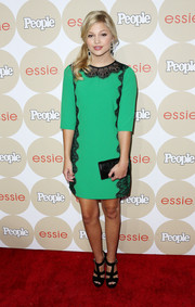 Olivia Holt went for classic elegance with this green shift dress featuring black lace embellishments during the Ones to Watch party.