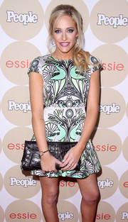 Carly Chaikin accessorized with an elegant black crocodile clutch when she attended People's Ones to Watch party.