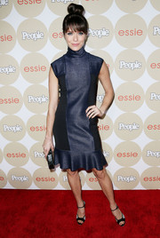Katie Aselton chose a midnight-blue cocktail dress with a high neck and a fluted hem for the Ones to Watch party.