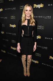 Greer Grammer continued the edgy-sexy vibe with a pair of knee-high peep-toe boots.