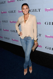 Emmanuelle Chriqui was all covered up but looked oh-so-sexy in her long-sleeve nude blouse and skinny jeans at the People StyleWatch Denim Awards.
