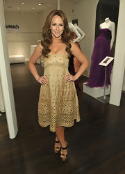 Jennifer Love Hewitt dazzled in the gleaming gold platform sandals she paired with a ladylike eyelet frock.