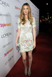 Whitney Port complemented her pastel sequined frock with nude leather peep toes.