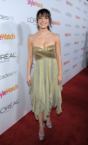 Sarah looks like a Grecian Goddess in a gold encrusted strapless gown with ombre chiffon pleats.
