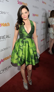 Rose McGowan toughened up her lime green halter dress with silver spiked peep toe Bridget boots.