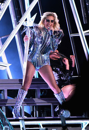 Lady Gaga completed her bedazzled look with a pair of knee-high boots, also by Versace.