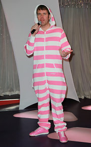 Perez Hilton wore matching pink sneakers with his striped onesie during the unveiling of Lady Gaga's wax figure.