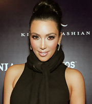 Kim Kardashian opted for a more sophisticated look while celebrating her appearance on 'The Apprentice'. She swept her long brunette locks up into a chic bun. How classy!