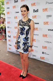 Emma wore a ladylike embroidered dress with a structured peplum to the Toronto Film Festival.