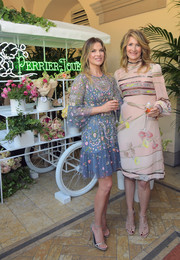 Laura Dern went the ladylike route in a long-sleeve, high-neck floral dress for the Perrier-Jouet Toasts Mother's Day event.