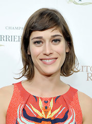 Lizzy kept her short chop casual by leaving a slight wave in her locks and opting for a brushed-aside bang.