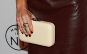 Sarah Shahi attended the 'Person of Interest' panel during PaleyFest carrying this simple yet elegant cream-colored hard-case clutch.