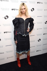Andreja Pejic injected some color with a pair of red mid-calf boots.
