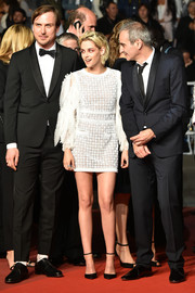 Kristen Stewart sealed off her look with simple black ankle-strap pumps by Christian Louboutin.