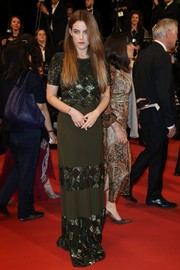 Riley Keough donned an army-green Louis Vuitton maxi dress with metallic panels for the Cannes premiere of 'Personal Shopper.'