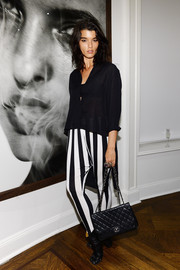 Black ankle boots rounded out Crystal Renn's look.