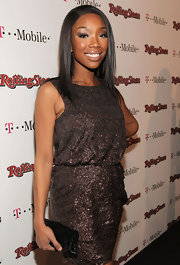 Brandy paired her sparkly dress with a black sequined clutch.