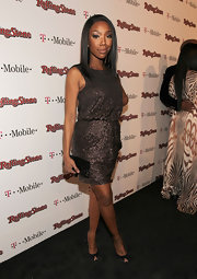 Brandy punctuated her look with classic black satin peep-toe pumps.