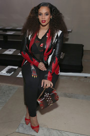 Dascha Polanco sported a perfectly coordinated gemstone purse, leather jacket, and pants combo at the Philipp Plein fashion show.