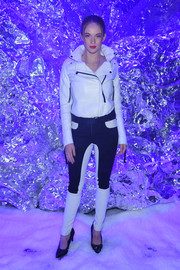 Larsen Thompson rocked a white leather biker jacket at the Philipp Plein fashion show.