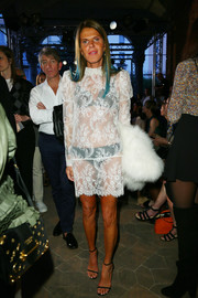 Anna Dello Russo flashed her black undies in a sheer white lace dress while attending the Philosophy di Lorenzo Serafini fashion show.