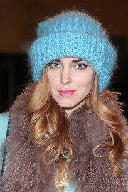 Chiara Ferragni beat the winter chill with a sky blue knit beanie at the Philosophy by Natalie Ratabesi runway show.