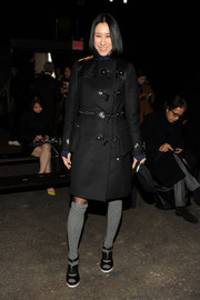Eva Chen donned a military-chic black trenchcoat for the Philosophy by Natalie Ratabesi fashion show.