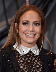 For her beauty look, Jennifer Lopez shunned color, opting instead for nude lipstick and neutral eyeshadow.