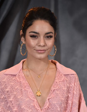 Vanessa Hudgens opted for a casual bun when she attended the photocall for 'Second Act.'