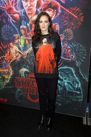 Winona Ryder teamed her top with black skinny jeans.