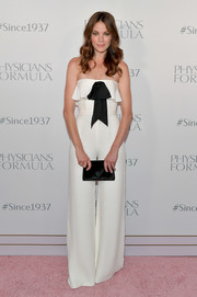 Michelle Monaghan looked cute and breezy in a strapless white Reem Acra jumpsuit with black bow detailing at the Physicians Formula 80th anniversary celebration.