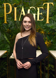 Elizabeth Olsen donned a black one-sleeve top for the Piaget Independent Film celebration.