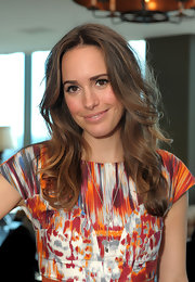 Louise Roe styled her brunette locks into soft bouncy curls at the Piaget Hollywood luncheon.