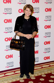 Kate Silverton carried a snakeskin bag on the red carpet with gold hardware.