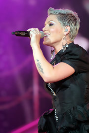 "Singer Pink has several tattoos, including a barcode on her neck, a bird on her back, and ""Sir Corky Moore"" on her arm that is rumored to be a tribute to a deceased family member."