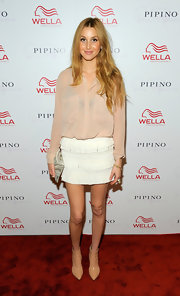 Whitney Port updated her feminine ensemble with modern pointy nude ankle boots.