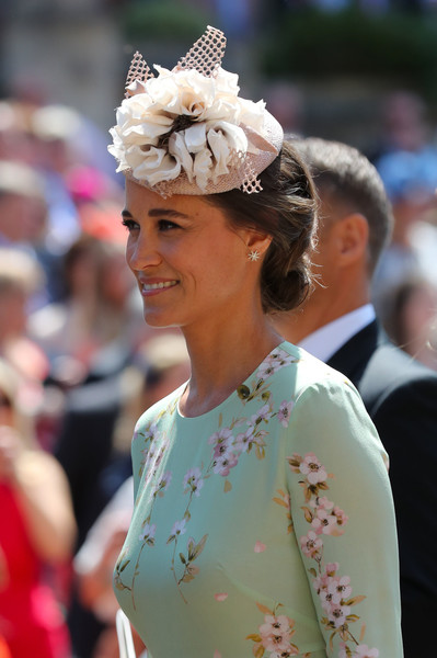 Pippa Middleton Fascinator [hair,headpiece,hairstyle,lady,hair accessory,tradition,fashion,headgear,fashion accessory,event,harry,meghan markle,pippa middleton,st georges chapel,england,windsor castle,wedding,pippa middleton,wedding of prince harry and meghan markle,wedding of prince william and catherine middleton,fascinator,wedding,fashion,hat,family of catherine duchess of cambridge,catherine duchess of cambridge,prince harry duke of sussex]