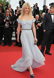 Clemence Poesy looked sweet and elegant in an off-the-shoulder pale blue evening gown for the Cannes Film Festival.